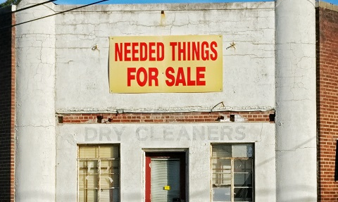 Needed things for sale sign on building Photo by Michael Prewett on Unsplash